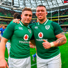 Jordan Larmour, left, and Andrew Porter of Ireland celebrate after win over Italy