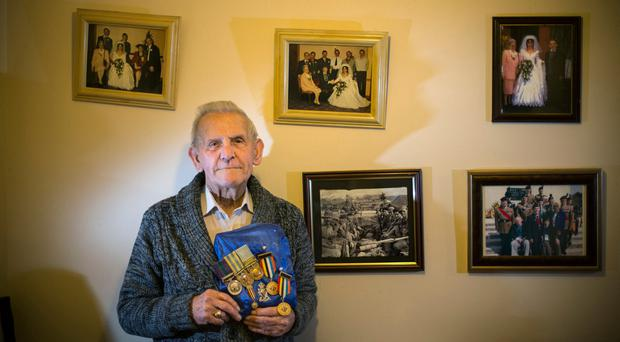 Irish soldier Tony Thorpe - who fought in Korea - with some of the medals he received Photo: Mark Condren