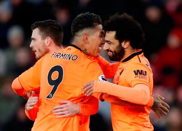 Liverpool's Mohamed Salah celebrates scoring their second goal with Roberto Firmino but Liverpool don't have much time before their next fixture