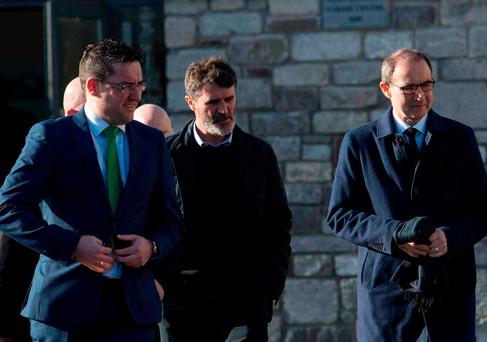 Roy Keane (centre) and Martin O'Neill (right) arrive for the funeral of former Celtic and Manchester United footballer Liam Miller, at St. John the Baptist Church in Ovens, County Cork. Clare Keogh/PA Wire