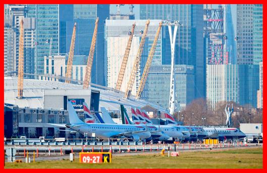 Planes on the apron at London City Airport which has been closed after the discovery of an unexploded Second World War bomb. Dominic Lipinski/PA Wire