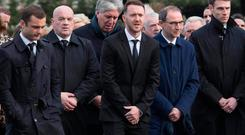 Shaun Maloney (left), Aiden McGeady (centre) and Martin O'Neill (second right) attend the funeral of former Celtic and Manchester United footballer Liam Miller, at St. John the Baptist Church in Ovens, County Cork