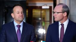 Taoiseach Leo Varadkar (left) and Irish Foreign Minister Simon Coveney speaking outside Stormont House in Belfast. Photo: Niall Carson/PA Wire