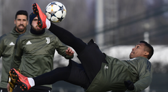 Douglas Costa flies through the air during training ahead of Juventus's clash against Tottenham in the Champions League tonight. Photo: Getty Images