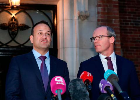 Taoiseach Leo Varadkar (left) and Minister for Foreign Affairs Simon Coveney speak outside Stormont in Belfast, following a bilateral meeting with British Prime Minister Theresa May