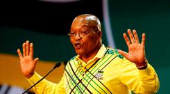 President of South Africa Jacob Zuma gestures to his supporters at the 54th National Conference of the ruling African National Congress (ANC) in Johannesburg, South Africa December 16, 2017. REUTERS/Siphiwe Sibeko/File Photo