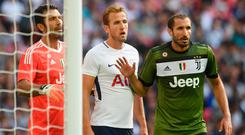 Harry Kane of Tottenham is marked by Gianluigi Buffon and Giorgio Chiellini of Juve
