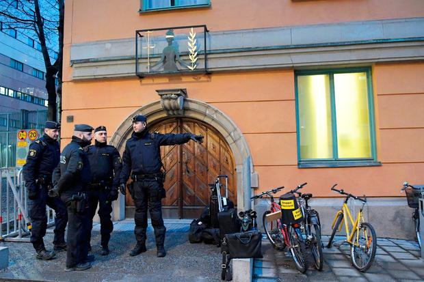 Police officers stand outside the Stockholm District Court, where the trial against the terror suspect, Uzbekistan citizen Rakhmat Akilov, who is suspect for terror attack in the central parts of Stockholm in April last year, started in Stockholm District Court, Stockholm, Sweden February 13, 2018. TT News Agency/Janerik Henriksson via REUTERS