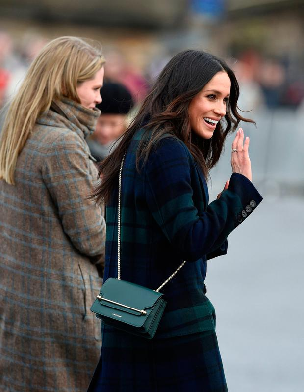 Meghan Markle greets wellwishers while on a walkabout on the esplanade at Edinburgh Castle, as she and Prince Harry visited Scotland
