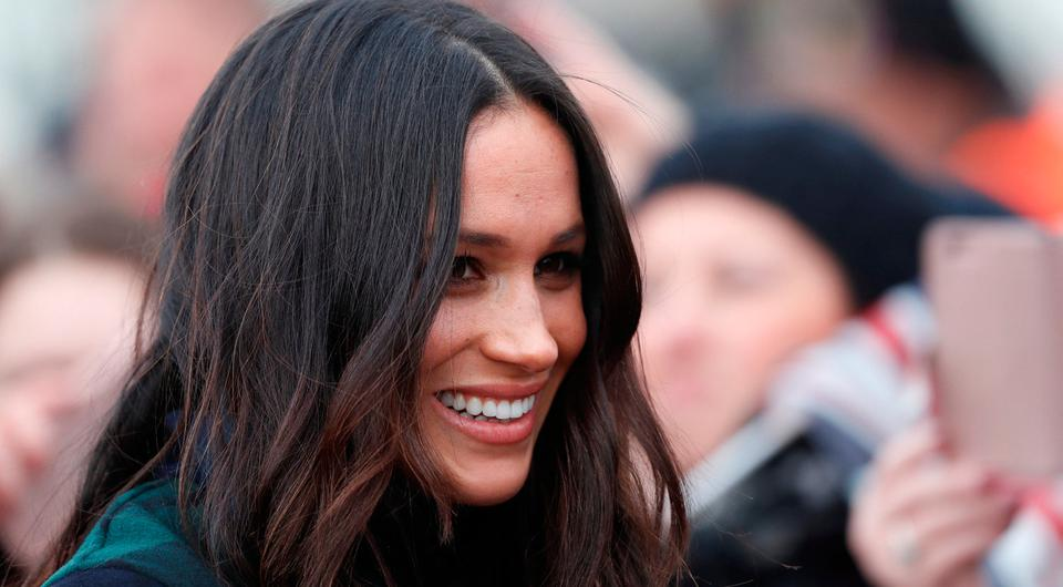 Meghan Markle, fiancee of Britain's Prince Harry, meets members of the crowd as she arrives for a visit to Edinburgh, Scotland February 13, 2018. REUTERS/Russell Cheyne