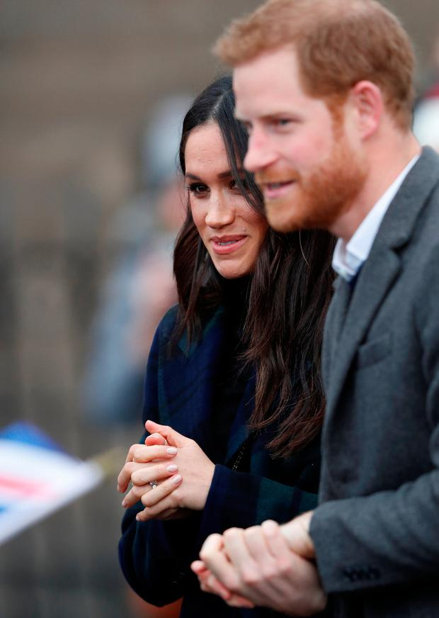 Meghan Markle, and Britain's Prince Harry, meet members of the crowd as they arrive for a visit to Edinburgh, Scotland February 13, 2018. REUTERS/Russell Cheyne