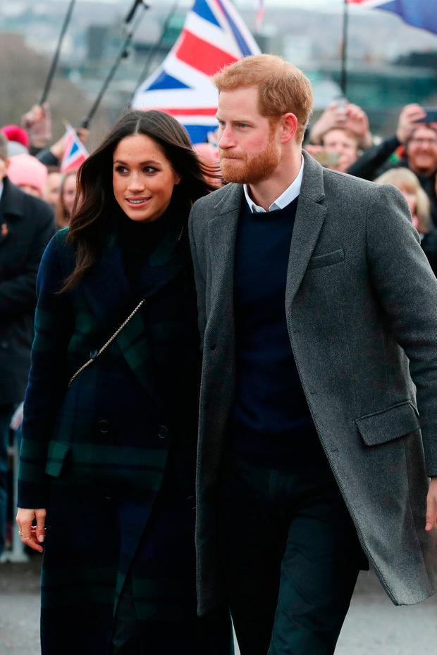 Prince Harry and Meghan Markle during a walkabout on the esplanade at Edinburgh Castle, during their visit to Scotland