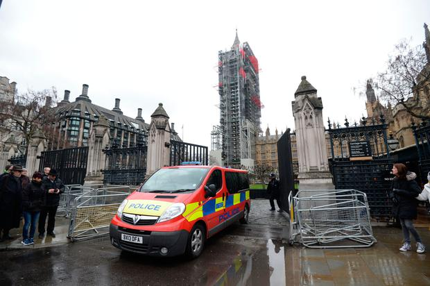 A police vehicle leaves the Palace of Westminster where police say that they are