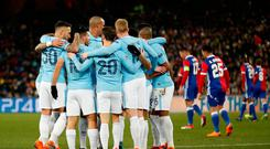 Soccer Football - Champions League - Basel vs Manchester City - St. Jakob-Park, Basel, Switzerland - February 13, 2018 Manchester City's Sergio Aguero celebrates scoring their third goal with team mates. Action Images via Reuters/Andrew Boyers