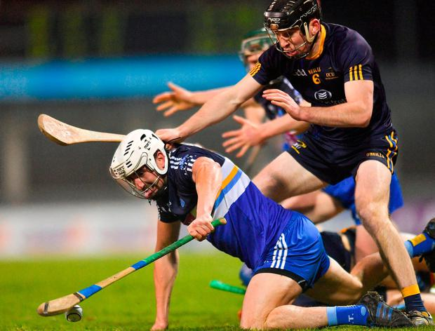 DIT's Patrick Maher in action against DCU's Conor Delaney. Photo: Eóin Noonan/Sportsfile