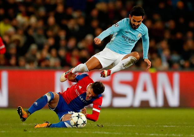 Manchester City's Ilkay Gundogan in action with Basel's Taulant Xhaka Photo: Reuters/Andrew Boyers