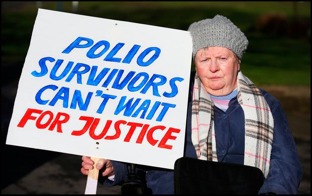 Polio survivor Joan Brady protesting outside the headquarters of Rehab yesterday. Photo: Steve Humphreys