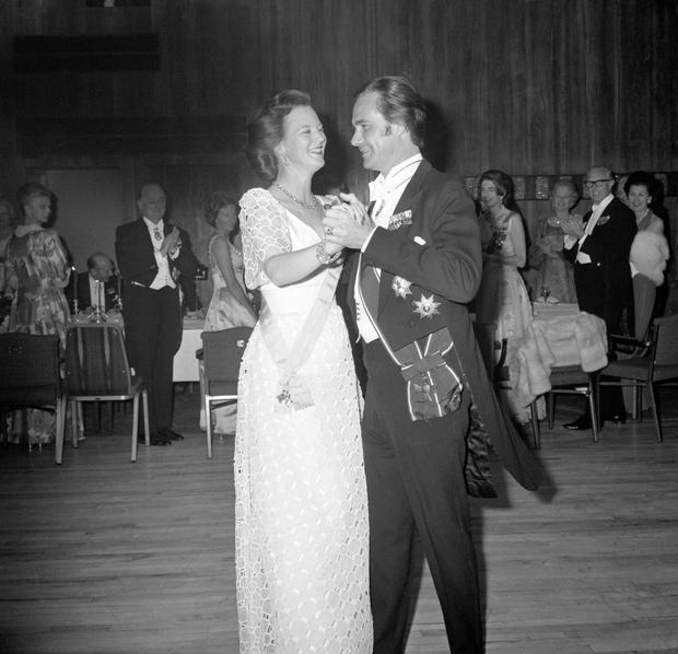 File photo dated 07/05/74 of Queen Margrethe of Denmark opening the dancing with her husband, Prince Henrik of Denmark, at the Anglo-Danish Society's Jubilee dinner and dance at the Royal Garden Hotel, London
