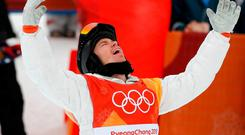 Gold medallist Shaun White of the U.S. celebrates. REUTERS/Jorge Silva