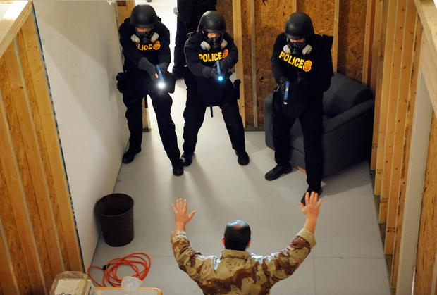 US Drug Enforcement Administration (DEA) Agents simulate a raid in their Tactical Training Facility. Photo: File photo via Tim Sloan/AFP/Getty Images
