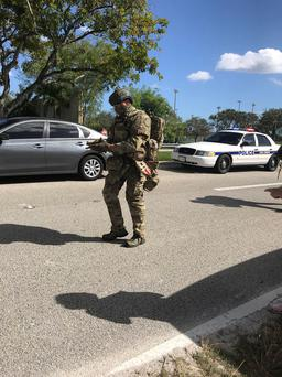 SWAT and police are seen in Coral Springs, Florida, U.S. February 14, 2018 in this image obtained from social media. Credit: TWITTER / @GRUMPYHAUS via REUTERS