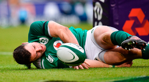Robbie Henshaw shows his discomfort after injuring his shoulder in the process of scoring a try against Italy Photo: Seb Daly/Sportsfile