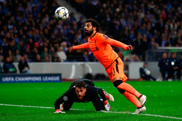 Tangerine dream: Mohamed Salah heads in Liverpool's second goal