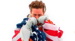 Shaun White shows his emotion after receiving the gold medal for the Snowboard Men's Halfpipe. Photo: David Ramos/Getty Images