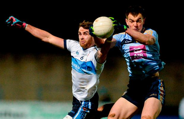 UCD's Jack Barry, right, holds onto the ball under pressure from Ronan McName. Photo: Oliver McVeigh/Sportsfile