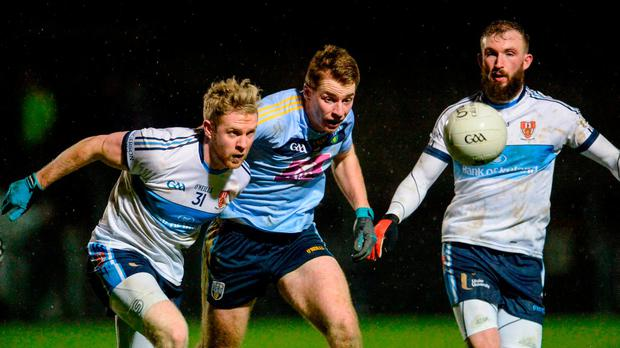 UCD's Barry O'Sullivan, centre, and Ulster University's Frank Burns and Terence O'Brien, compete for a loose ball. Photo: Oliver McVeigh/Sportsfile