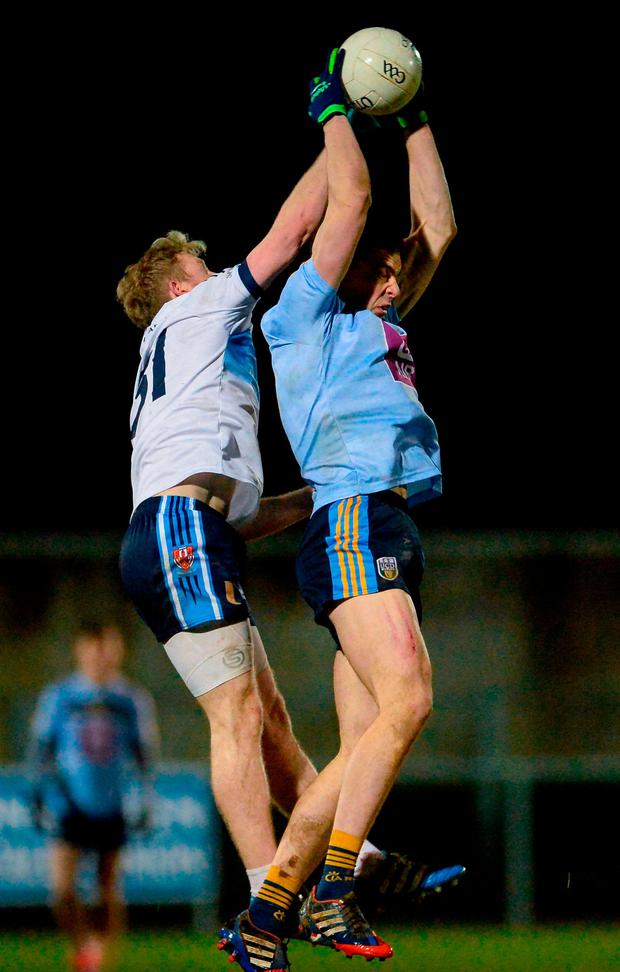 Jack Barry, right, and Frank Burns compete for possession in the air. Photo: Oliver McVeigh/Sportsfile