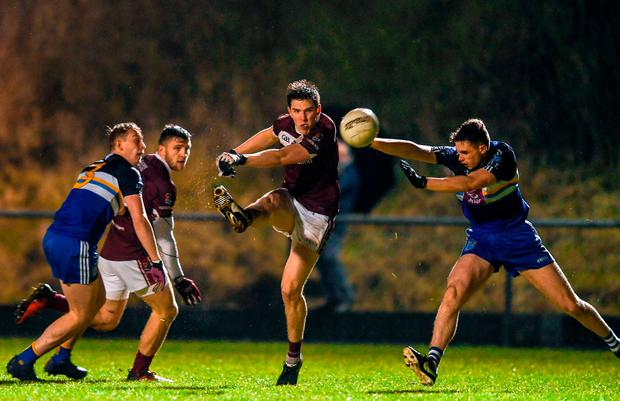 NUIG's Ruairi Greene gets a shot away. Photo: Sam Barnes/Sportsfile