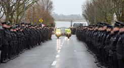 Gardaí form a guard of honour for Detective Superintendent Colm Fox, who died at the weekend Photos: Mark Condren