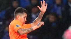 Roberto Firmino celebrates his goal in Liverpool's comprehensive victory against Porto last night Photo: AP Photo/Luis Vieira