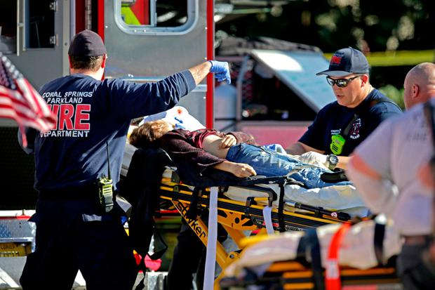 Medics attend to a shot student. (John McCall/South Florida Sun-Sentinel via AP)
