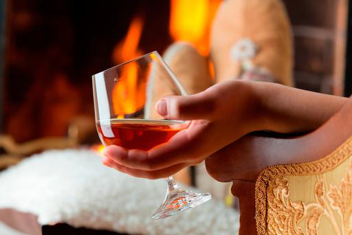 Enjoy a drink, such as a cognac, in front or a roaring fire