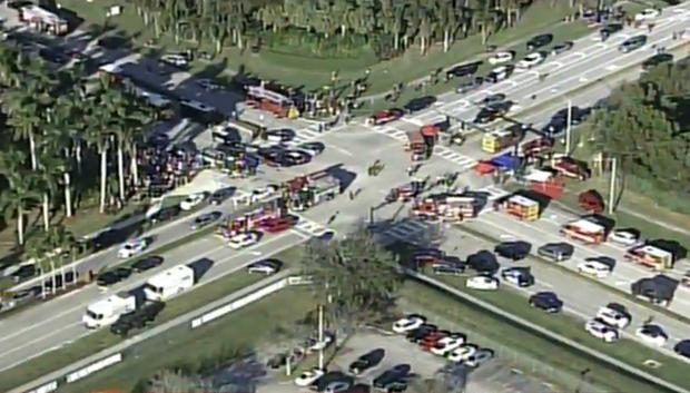 Police and rescue workers attend the scene near Marjory Stoneman Douglas High School following a shooting incident in Parkland, Florida, U.S. February 14, 2018 in a still image taken from a video. WSVN.com via REUTERS.