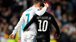 Real Madrid's Cristiano Ronaldo (L) and Paris Saint-Germain's Neymar