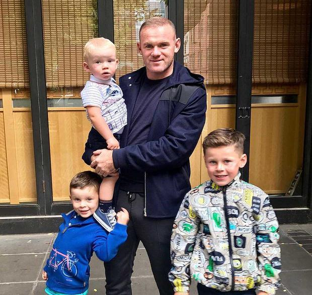 Wayne Rooney and his children Kai, Kit and Klay