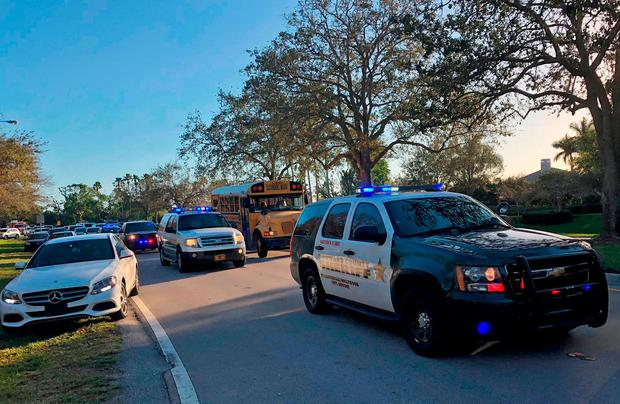 Sheriff vehicles are seen at Marjory Stoneman Douglas High School in Parkland, Florida following a school shooting. AFP PHOTO / Michele Eve SANDBERGMICHELE EVE SANDBERG/AFP/Getty Images