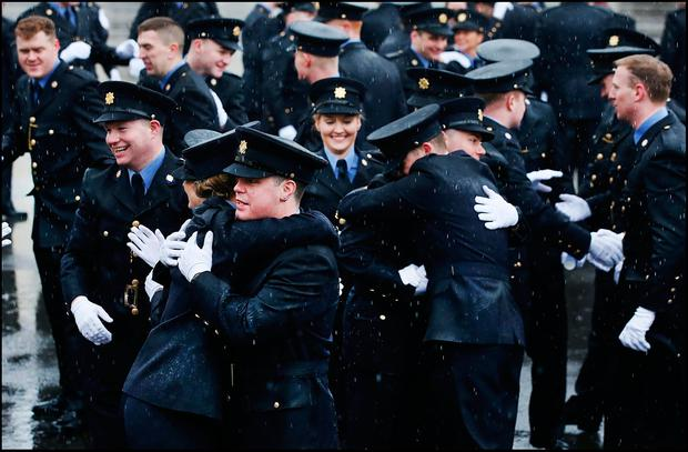 Gardaí celebrate after the passing out ceremony of probationer gardaí at the Garda College in Templemore in 2017 Photo: Steve Humphreys