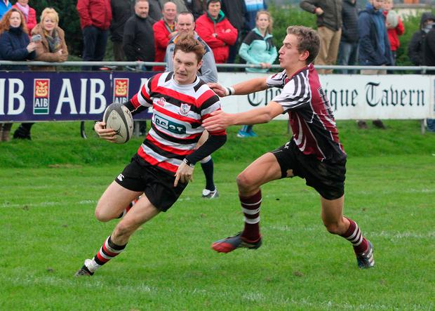 Enniscorthy's Daniel Pim avoids a tackle at Ross Road. Pic: John Walsh