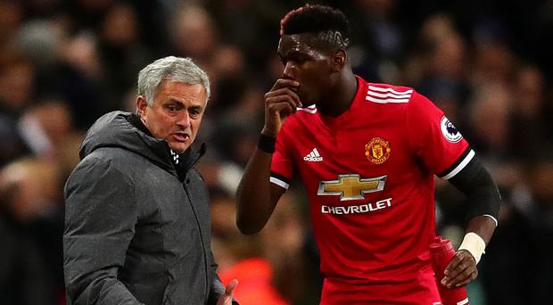 Jose Mourinho appears to be struggling to get his point across to Paul Pogba. Photo: Getty