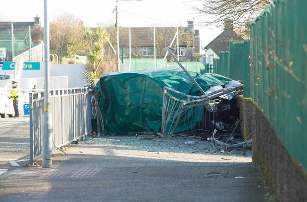 The wreckage of the car in which Danny Barnes died is covered by a tarpaulin. Photo: Mary Browne