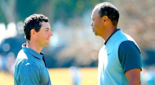 Rory McIlroy and Tiger Woods shake hands after finishing their round during the first round of the Genesis Open at Riviera Country Club. Photo: Getty