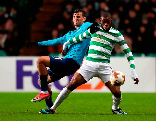 Celtic's Olivier Ntcham (right) and Zenit St Petersburg's Alexander Erokhin battle for the ball. Photo: PA
