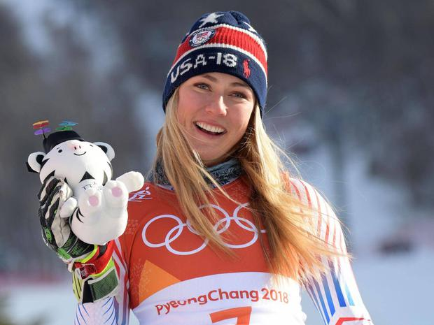Mikaela Shiffrin holds up her Soohorang mascot after winning the women's Giant Slalom
