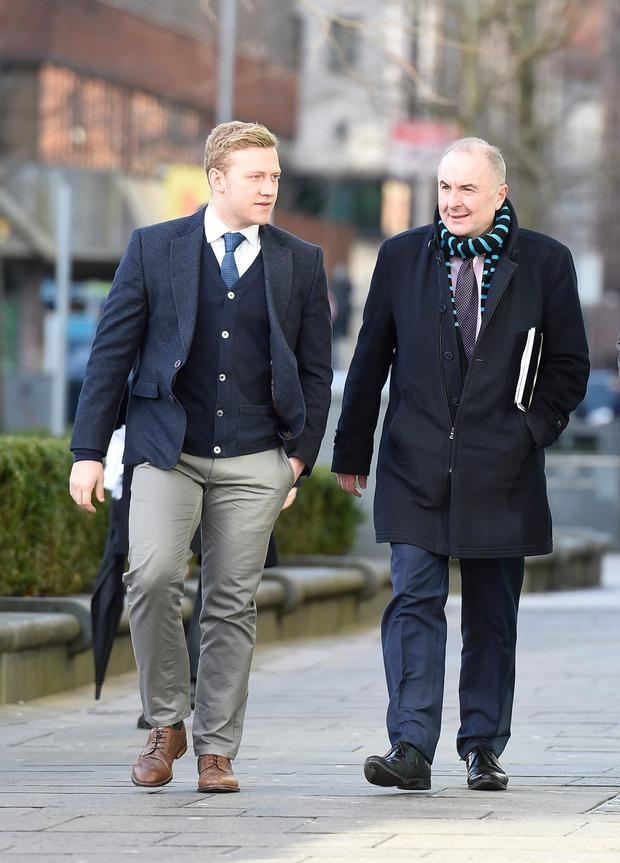 Ireland and Ulster rugby player Stuart Olding (left) arrives at Belfast Crown Court. Photo: Michael Cooper/PA Wire