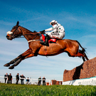 Tara Bridge, with Tom Cannon up, clears the last on the way to winning The 'Ubique' Handicap Chase at Sandown yesterday. Photo: Alan Crowhurst/Getty Images