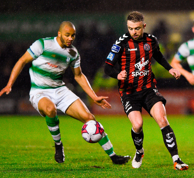 Keith Ward of Bohemians in action against Ethan Boyle of Shamrock Rovers during last night's match. Photo: Matt Browne/Sportsfile